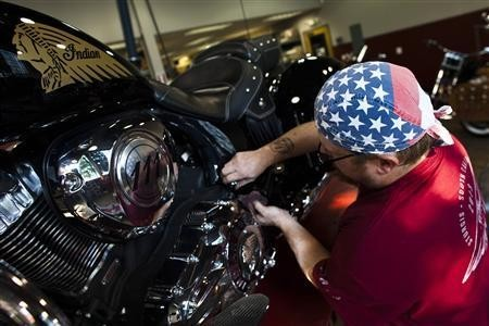 A mechanic checks the engine of an Indian motorcycle at the showroom of Indian Motorcycles of Northern New Jersey in Union, August 20, 2013.