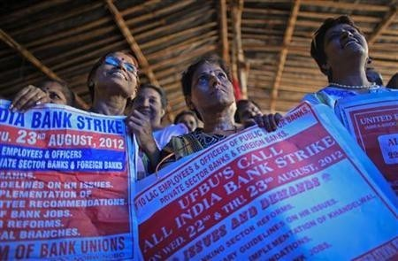 Bank employees hold placards at a rally during a two-day strike in Mumbai August 22, 2012