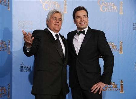 Late night talk show hosts Jay Leno (L) and Jimmy Fallon pose backstage at the 70th annual Golden Globe Awards in Beverly Hills, California, January 13, 2013.
