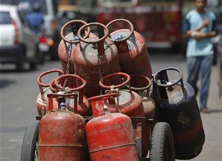 A man walks past gas cylinders loaded on a cart in Mumbai (Representational Picture, Reuters)