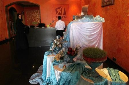 A table set with decorations is seen at Iranian restaurant Abshar in Dubai March 20, 2013 to celebrate the Iranian New Year.