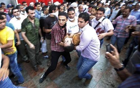 Members of the Muslim Brotherhood take cover in Cairo
