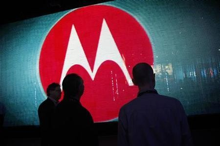 Visitors look at a video display at the Motorola booth
