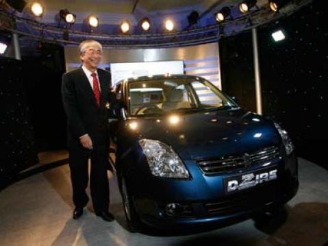 Managing Director of Maruti Suzuki, Shinzo Nakanishi, poses with the Dzire