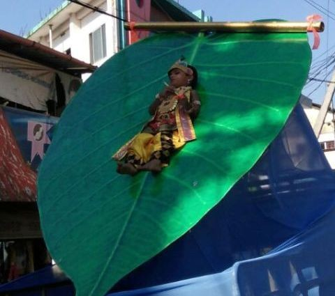 Child tied to peepal leaf