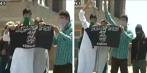 Kashmiri youth pose with an Isis flag on 24 July at Jamia Masjid in Srinagar.