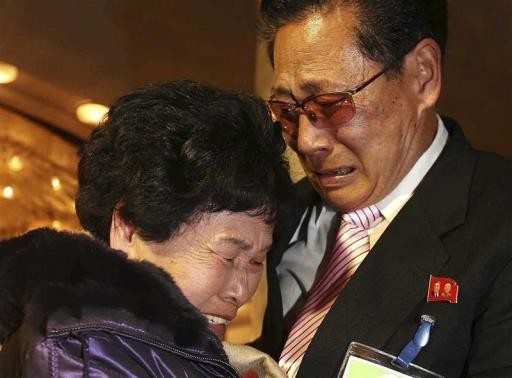 North Korean Lee Yun-geun (R), 72, hugs his South Korean sister Lee Sun-hyang, 88, during their family reunion at the Mount Kumgang resort in North Korea February 20, 2014.