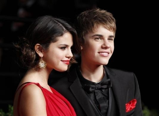 Singers Justin Bieber and Selena Gomez Arrive at the 2011 Vanity Fair Oscar Party in West Hollywood