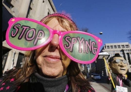 The founder of the protest group Code Pink Medea Benjamin wears large sunglasses as she protests against U.S. President Barack Obama and the NSA before his arrival at the Department of Justice