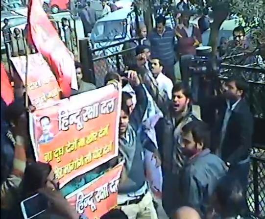 Hindu Raksha Dal activists pose for cameras after vandalizing AAP office in Ghaziabad 8 January 2013