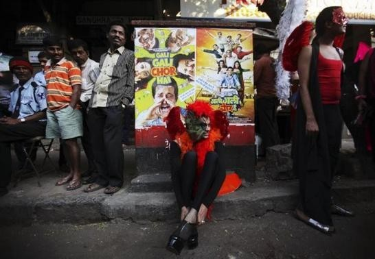 A participant wears his shoes on a sidewalk during Queer Azaadi (freedom) parade, an event promoting gay, lesbian, bisexual and transgender rights in Mumbai January 28, 2012.