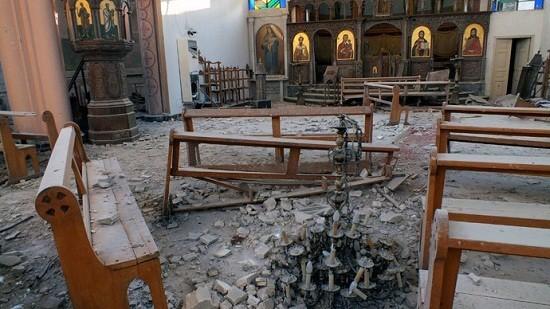 A fallen chandelier lies on debris in Im Al-Zinar church that was damaged during an air-raid in December,2013/Reuters