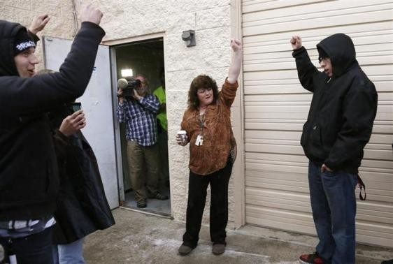 Cheri Hackett, (C) co-owner of the Botana Care marijuana store celebrates just before opening her doors to customers for the first time in Northglenn, Colorado January 1, 2014