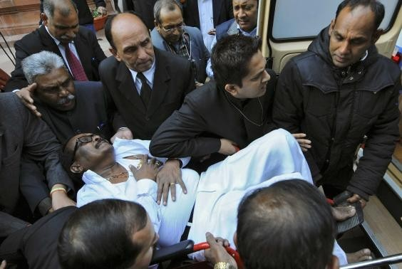 K Narayana Rao, an Indian parliamentarian, is rushed to a hospital after he collapsed inside the parliament in New Delhi February 13, 2014.