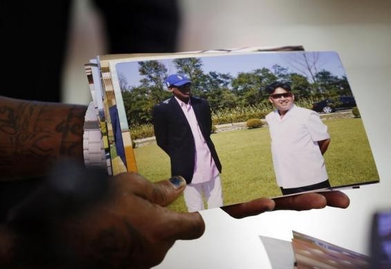 Dennis Rodman shows a picture which he took with North Korean leader Kim Jong-un as he arrives at Beijing Capital International Airport September 7, 2013. REUTERS