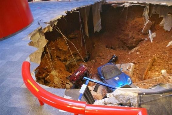 A 40-foot sinkhole that opened up under the National Corvette Museum and swallowed eight Corvettes, including the historic 1992 White 1 Millionth Corvette, in Bowling Green, Kentucky February 12, 2014 is seen in this handout provided by the museum.