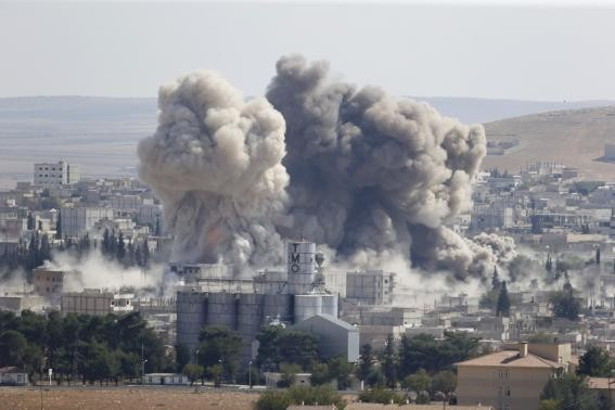 An explosion in Kobane, after an ISIS suicide bomber blew up a truck near a YPG hideout.