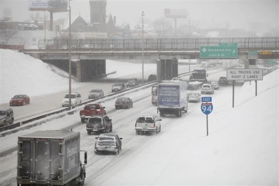 Motorist drive along a snow covered Interstate-94 in Detroit, Michigan January 2, 2014