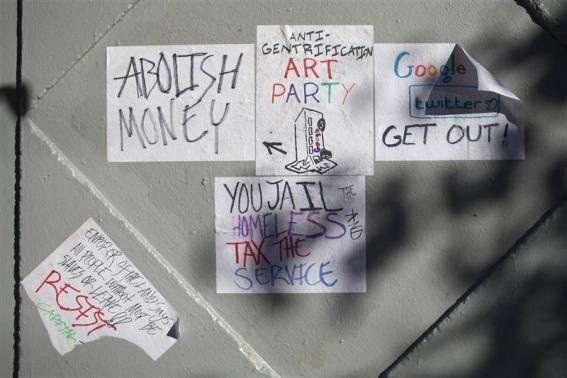 Signs in opposition of technology companies are seen in San Francisco, Calif. on Dec. 9, 2013. A Google Inc commuter bus was blocked in San Francisco's Mission district for about a half hour Monday morning, highlighting many residents' growing concern that an influx of affluent technology workers is driving up costs in the city. Reuters