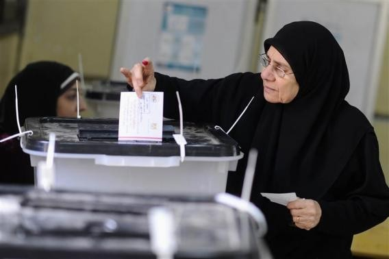 A woman casts her vote at a polling centre during a referendum on Egypt's new constitution in Cairo January 14, 2014.