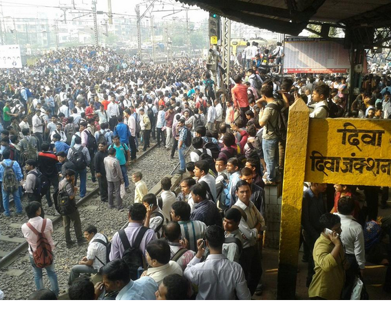 Commuters at Diva station,where angry protesters pelted stones and burned vehicles over delayed train.