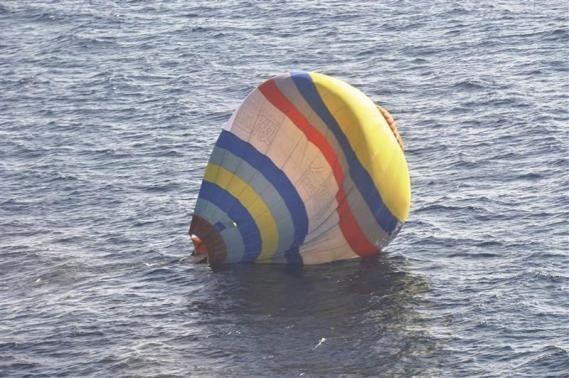 A hot-air balloon drifting on the ocean is seen in the East China Sea near the disputed isles known as Senkaku isles in Japan and Diaoyu islands in China
