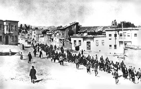 Armenians are marched to a nearby prison in Mezireh by armed Turkish soldiers. Kharpert, Armenia, Ottoman Empire, April, 1915