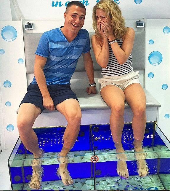 Colton Haynes and EMily Bett Rickards get fish massage