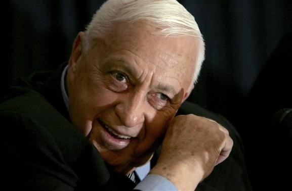 Israeli Prime Minister Ariel Sharon speaks to the media during a news conference in Tel Aviv in this December 1, 2005 file photo/REUTERS