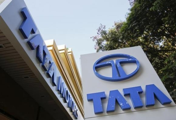 Tata Motors logos are pictured outside their flagship showroom in Mumbai May 28, 2013.