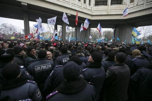 Ukrainian police separate ethnic Russians and Crimean Tatars. Here are five reasons why tensions could lead to a war between Ukraine and Russia. (Reuters)