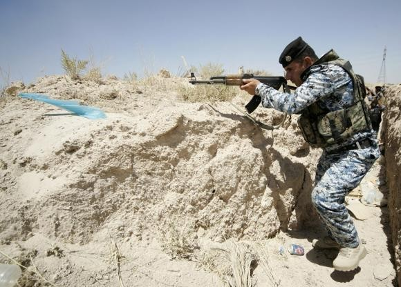 A member of the Iraqi security forces takes position during a patrol looking for militants of the ISIS at the border between Iraq and Saudi Arabia in June.