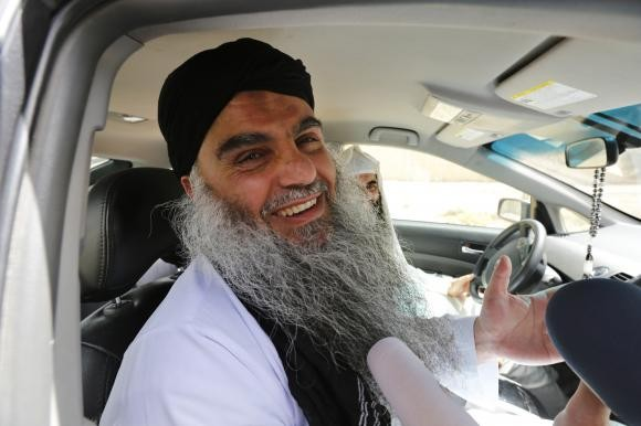Radical Muslim cleric Abu Qatada speaks to the media after his release from prison near Amman September 24, 2014.