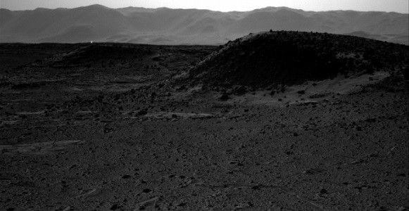 This image from NASA's Curiosity Mars rover, taken on April 3, 2014, includes a bright spot near the upper left corner. Possible explanations include a glint from a rock or a cosmic-ray hit. (NASA/JPL-Caltech)