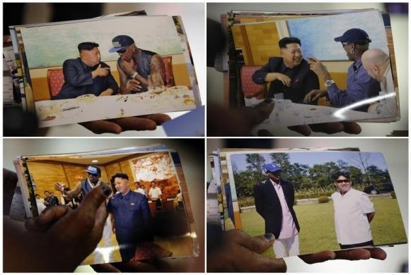 Dennis Rodman shows pictures he took with North Korean leader Kim Jong-un to the media, upon arrival at Beijing Capital International Airport, in this combination picture, September 7, 2013. REUTERS