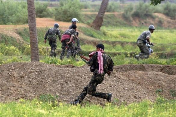 (Representational image) Paramilitary forces take cover during a gunfight with Maoists in Lalgarh.