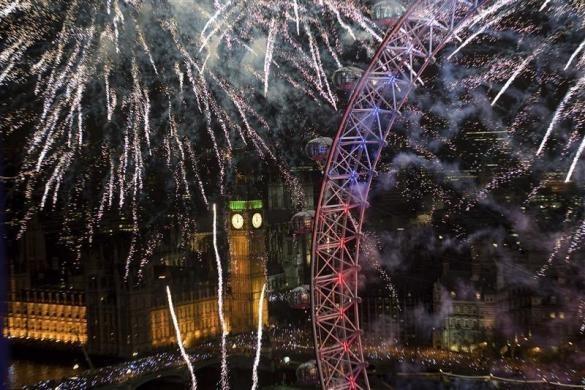 Fireworks explode across the skyline near the London Eye during New Year celebrations in London