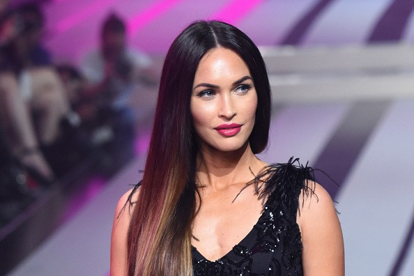 Megan Fox dazzles in a semi-sheer feathered gown at the Fashion Fest AW17 show in Mexico - Photos
