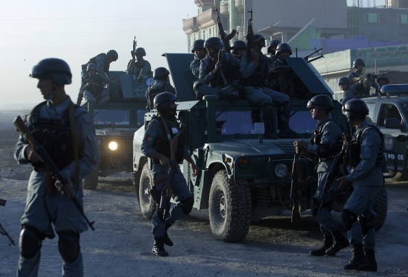 Afghan police arrive at the site of an attack in Kabul June 10, 2013. Explosions were heard by Reuters witnesses and there were reports of gunfire near Afghanistan's main international airport early on Monday, and a police spokesman said insurgents had launched the attack.(OMAR SOBHANI/REUTERS)