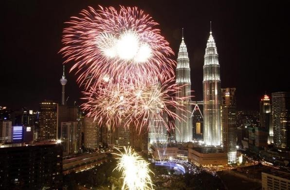 Fireworks explode near the Malaysia's landmark Petronas Twin Towers during New Year celebrations in Kuala Lumpur