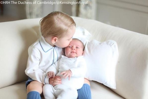 Prince George kisses little sister Princess Charlotte