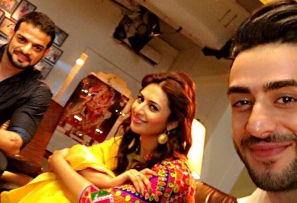 """Yeh Hai Mohabbatein"" slips down to 7th position in TRP ratings. Pictured: ""Yeh Hai Mohabbatein"" actors Karan Patel (on the left), Divyanka Tripathi Dahiya and Aly Goni (on the right)."