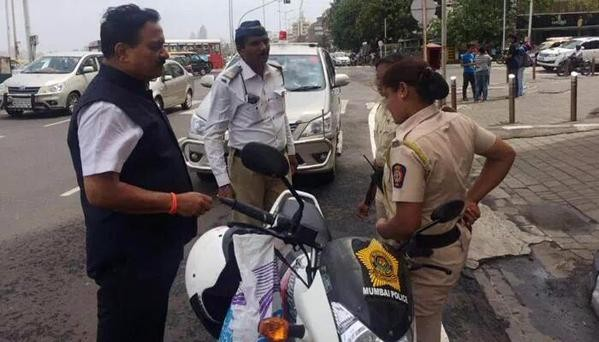 Mumbai Cops fined by Transport Minister for not wearing helmet