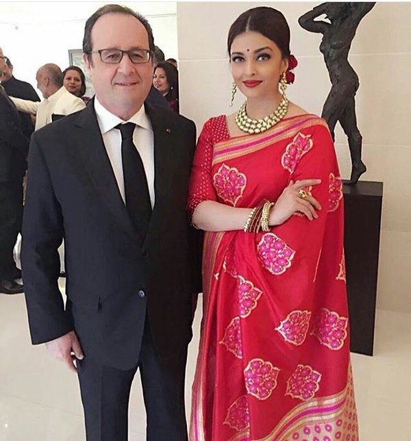 Aishwarya Rai Bachchan,Aishwarya Rai,Aishwarya Rai Bachchan at Hollande Lunch,Hollande Lunch,French President Francois Holland,Aishwarya looks ravishing in red sari for Hollande lunch,Aishwarya in red sari,Actress Aishwarya Rai Bachchan,Aishwarya Rai new