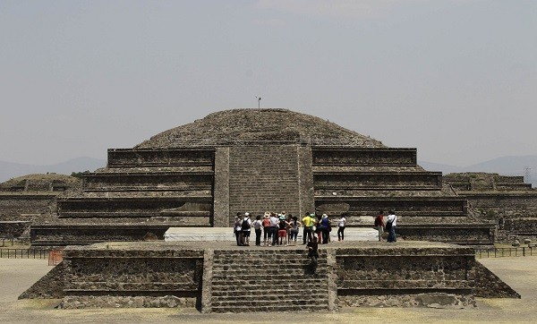 Visitors look on at the archaeological area of the Quetzalcoatl Temple near the Pyramid of the Sun