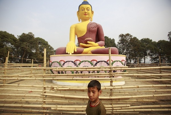 A child plays in front of a giant idol of Lord Buddha in Lalitpur. (Representational image)