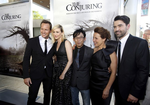 James Wan poses on the red carpet with (from left) Wilson, Farmiga, Taylor and Livingston.