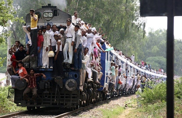 Hindu devotees travel in an overcrowded passenger train after taking a holy dip and offering prayers in the waters of Brahma Sarovar, a sacred pond, during a solar eclipse in the northern Indian city of Kurukshetra July 22, 2009