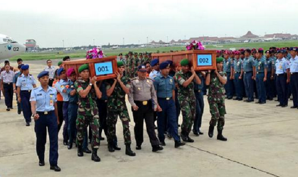 First two bodies being brought to Surabaya military base.
