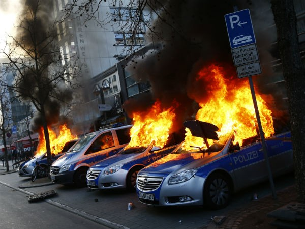 German police cars set on fire